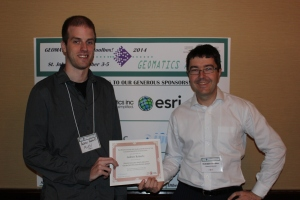 Andrew recieving his award from the Chair of the Newfoundland and Labrador branch of the CIG, Dr. Rodolphe Devillers